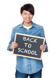 Asian young man with chalkboard showing phrases of back to schoo Royalty Free Stock Photo