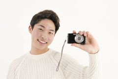 Asian young man with digital camera Stock Photo