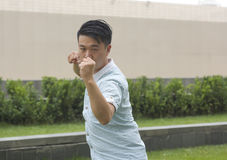 Asian young man display Chinese KongFu. Or young Man In a Fight. Business concept Stock Photos