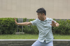 Asian young man display Chinese KongFu. Stock Photography