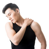 Asian young man having shoulder pain Stock Photo