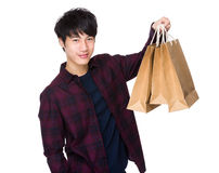 Asian Young Man hold with shopping bag Royalty Free Stock Images