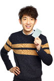 Asian young man holding card Stock Image
