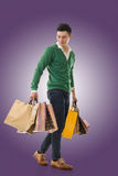 Asian young man holding shopping bags Stock Photo