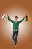 Asian young man holding shopping bags Stock Images