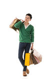 Asian young man holding shopping bags Royalty Free Stock Photos