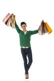 Asian young man holding shopping bags Stock Photography