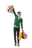 Asian young man holding shopping bags Stock Photos