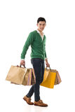 Asian young man holding shopping bags Stock Image