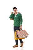 Asian young man holding shopping bags Royalty Free Stock Image