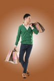 Asian young man holding shopping bags Royalty Free Stock Photo