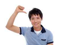 Asian young man indicate himself. Royalty Free Stock Images