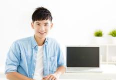 asian Young man with laptop Stock Photos