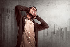Asian young man listen to music via headphone Stock Photography