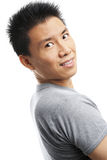 Asian young man looking at camera Royalty Free Stock Photography