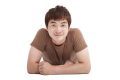 Asian young man lying on the floor Stock Image