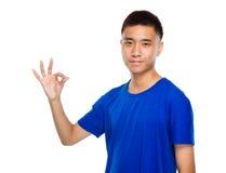 Asian young man with ok sign Stock Photos