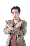 Asian Young man pumped up, making X sign shape with his arms and Royalty Free Stock Photo