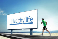 Asian young man running on beach, Sport concept with a big billb Stock Photos