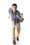 Asian young man running Stock Photo