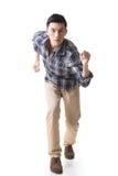 Asian young man running Stock Photo