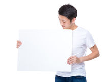 Asian young man showing placard Stock Photo