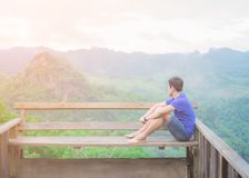 Asian Young Man, Sitting on the in front of the balcony. him are thinking something. stock photos
