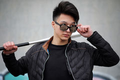 Asian young man on the street posing at the camera Royalty Free Stock Photo