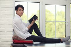 Asian young man student. With books in hands Royalty Free Stock Image