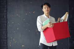 Asian young man student. With books in hands Royalty Free Stock Images