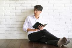 Asian young man student with books. In hands Royalty Free Stock Photo