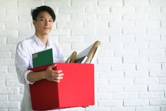 Asian young man student with books. In hands Royalty Free Stock Photos
