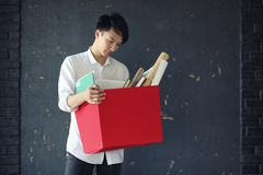 Asian young man student. With books in hands Stock Photography