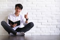 Asian young man student with books. In hands Stock Photo