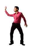 Asian young man in stylish pose. Stylish asian young man in pink shirt with action pose Stock Image