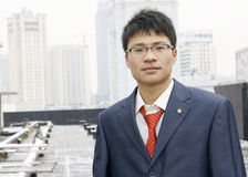 Asian young man in suit with tie Royalty Free Stock Photo