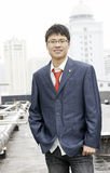 Asian young man in suit with tie Stock Photo