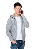 Asian young man talk to cellphone Stock Photos