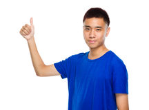 Asian young man with thumb up Royalty Free Stock Images