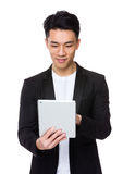 Asian young man use the digital tablet Royalty Free Stock Photos
