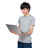 Asian young man use notebook computer Stock Photo