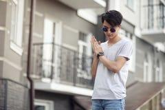 Asian young man wearing sunglasses outdoors Stock Photos