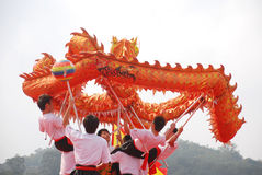 Asian young men dragon dance Royalty Free Stock Images