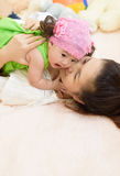 Asian young mom hold baby. royalty free stock image