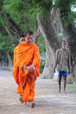 Asian young monks walking morning alms Royalty Free Stock Image