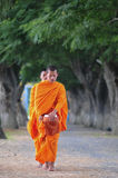 Asian young monks walking morning alms Royalty Free Stock Photography