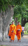 Asian young monks walking morning alms Royalty Free Stock Photos