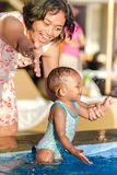Asian Young Mother Encourage Toddler Having Fun at Swimming Pool Stock Image