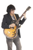 Asian young musician. Playing guitar isolated on white background Royalty Free Stock Photos