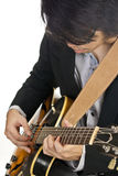 Asian young musician playing guitar. Isolated on white background Royalty Free Stock Photos